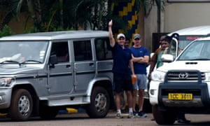 John Armstrong (left) gestures next to Nicholas Simpson as they leave prison in Chennai