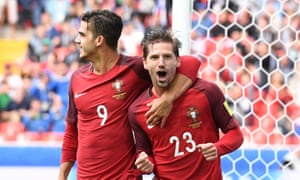 Adrien Silva (right) celebrates with André Silva after scoring an extra-time penalty for Portugal.