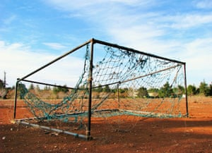 An abandoned football ground is photographed in the Golan Heights near the Syrian border