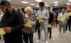 Georgians wait in line to cast their votes in the 2018 US midterm elections in Snellville, Georgia.