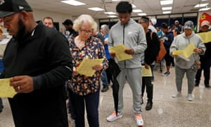 Georgians wait in line to cast their votes in the 2018 midterm election at a Gwinnett county polling place in Annistown elementary school in Snellville. Many in Snellville waited hours.