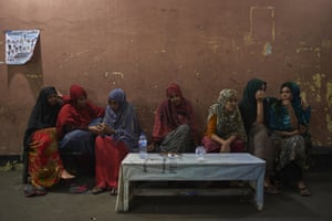 Somalian refugee women sit at the Mosque of Al Barokah in Jakarta for safety at night. Like many Somalian refugee women smuggled to Indonesia after Al-Shabaab militants raped them or murdered their family, they have fallen through the aid safety net and live on the street.