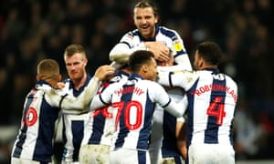 Jake Livermore is mobbed by his teammates after his late winner