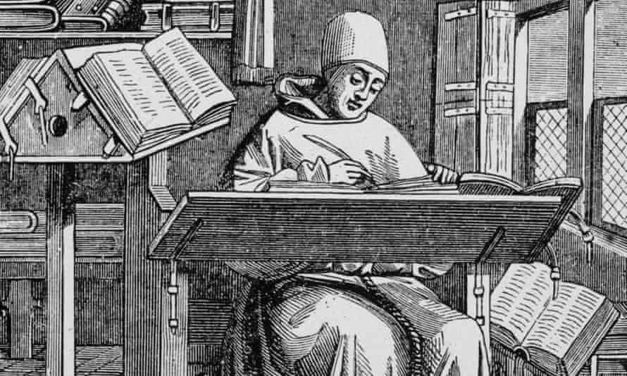 A medieval scribe writes at his desk.