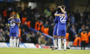 Chelsea players hug at the end of the match.