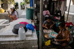 'I know we haven't given her enough guidance with school,' said Lovely Joy's grandmother Angeline Delos Santos, 'but if we don't take care of our business, we would have nothing to feed the kids. I just hope that she finishes school, gets a good job, and ultimately finds a life outside this cemetery.'