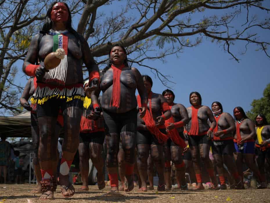 Indigenous women from the Xikrin tribe demonstrate in Brasília.