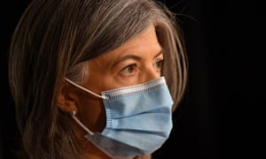South Australia's chief health officer, Nicola Spurrier, urges people to wear masks even as restrictions are being eased.