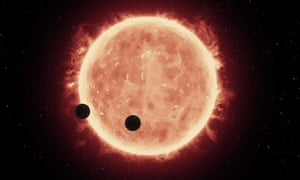 An artist's view of the planets' double transit of Trappist-1. Observations helped ruled out atmospheres made of hydrogen, but researchers still have more scenarios to consider.