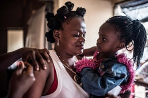 Barmany and her daughter Malux are among those getting vaccinated by the DRC government for free