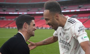 Mikel Arteta celebrates with Pierre-Emerick Aubameyang after the striker scored the winning Community Shield penalty against Liverpool.