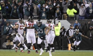 Philadelphia players react after an incomplete pass from Atlanta all but seals victory.