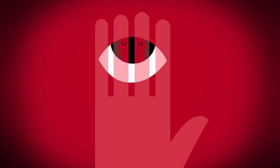 Eye with two faces looking in opposite directions on a hand