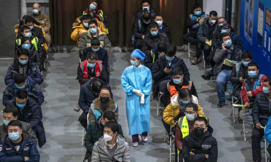 Chinese workers waiting for a jab at a mass vaccination centre for Chaoyang district in Beijing.