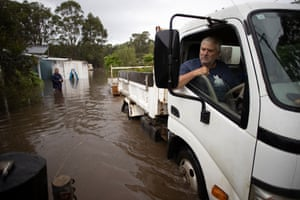 Shane Rowley backs up a trailer to his flooded house
