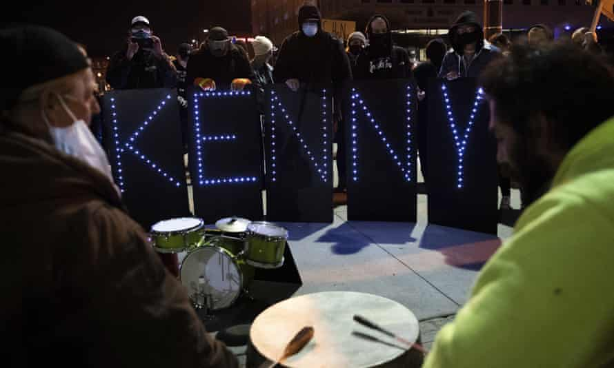 Protesters gather for a second night outside the Omaha police department headquarters on Saturday.