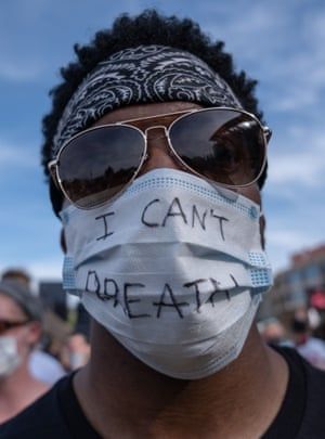 "A protesters in Detroit wearing a face mask with the words ""I can't breath"" which have come to symbolise George Floyd's death at the hands of the police"