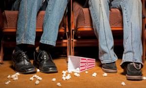 Spilt popcorn at feet of cinemagoers