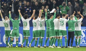 Werder Bremen players and fans celebrate after their 2-0 win at Schalke earlier this month.