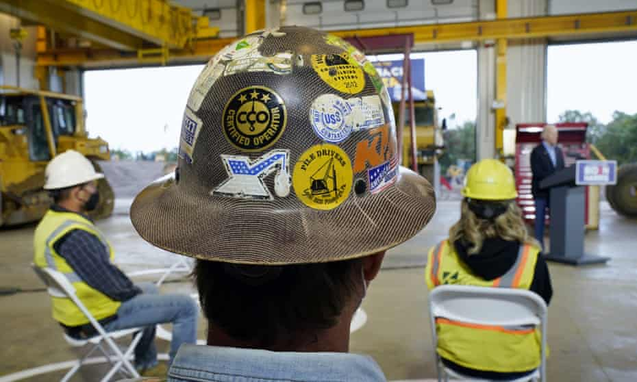 People listen as then Democratic presidential candidate Joe Biden speaks after touring International Union of Operating Engineers Local 66, in New Alexandria, Pennsylvania, in September 2020.