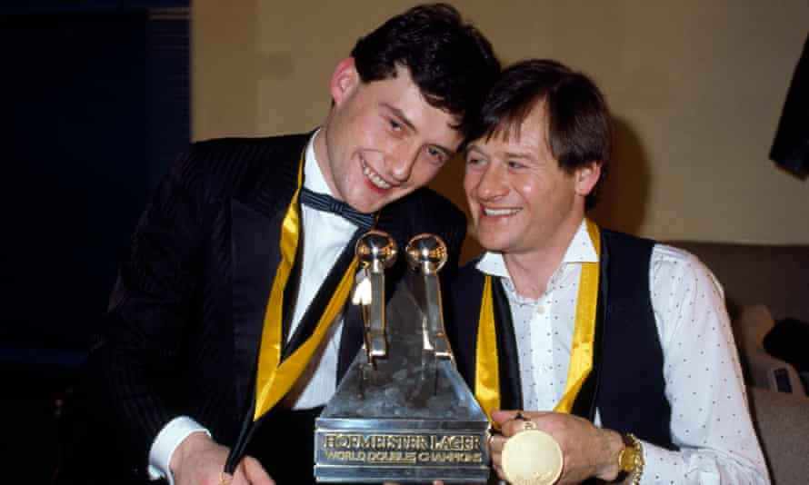 Jimmy White Alex Higgins after winning a doubles title together in 1984.