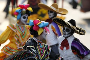 Performers participate in the Day of the Dead parade on Mexico City's main Reforma Avenue
