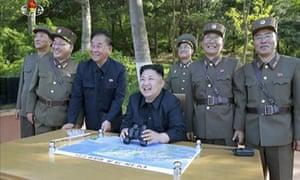 Kim Jong-un smiles with binoculars