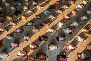 Surabaya, Indonesia: Muslims attend Eid al-Adha prayers with social distancing