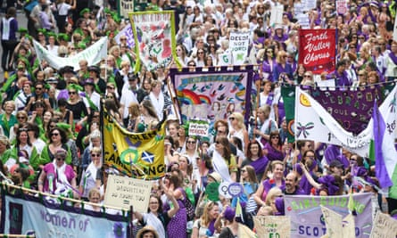 Marchers in Edinburgh commemorate 100 years since women won the right to vote.