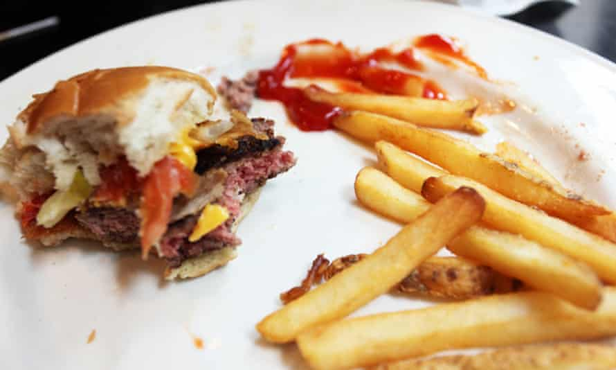 Half-finished hamburger and fries.