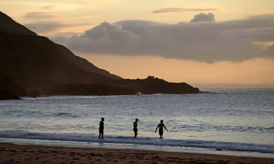 Early-morning swimmers at Rotherslade Bay, near Swansea, last month.