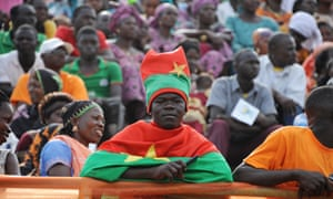 A supporter of Burkina Faso presidential candidate Roch Marc Christian Kabore attends a campaign meeting in Bobo Dioulasso.