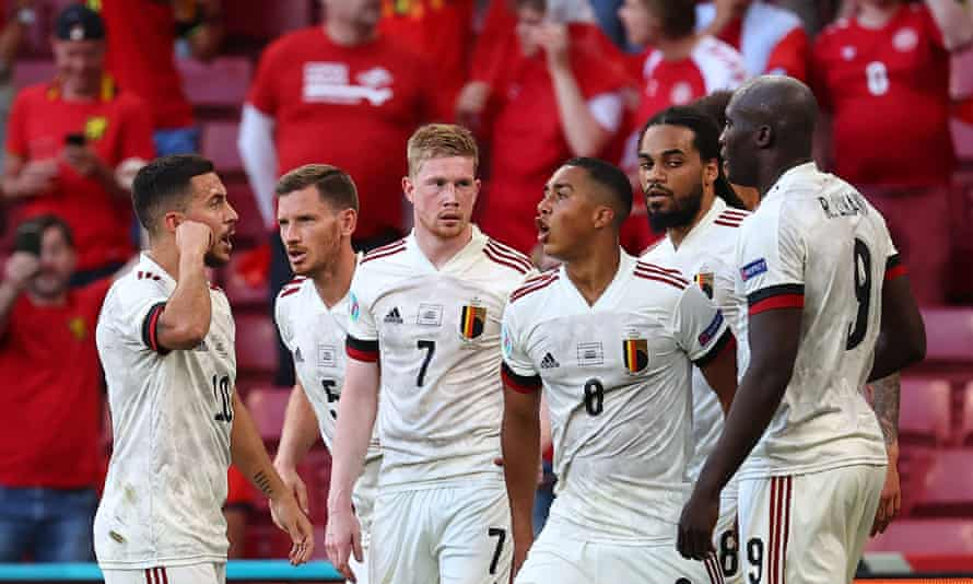 Belgium's midfielder Kevin De Bruyne celebrates with teammates after scoring his team's second goal against Denmark.