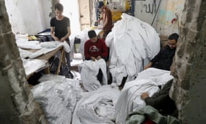 Palestinians make protective overalls meant to shield people from the coronavirus, to be exported to Israel, at a local factory, in Gaza City. Credit: AP Photo/Adel Hana.