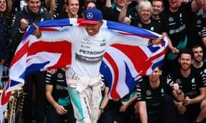 Lewis Hamilton celebrates winning the race and the 2015 F1 world championship.