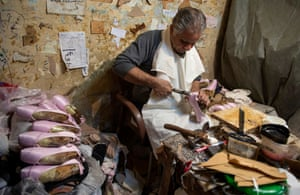 Giza, Egypt. Mahmoud Saleh produces handmade ballet shoes at his workshop for the Cairo Opera House and other companies around the world