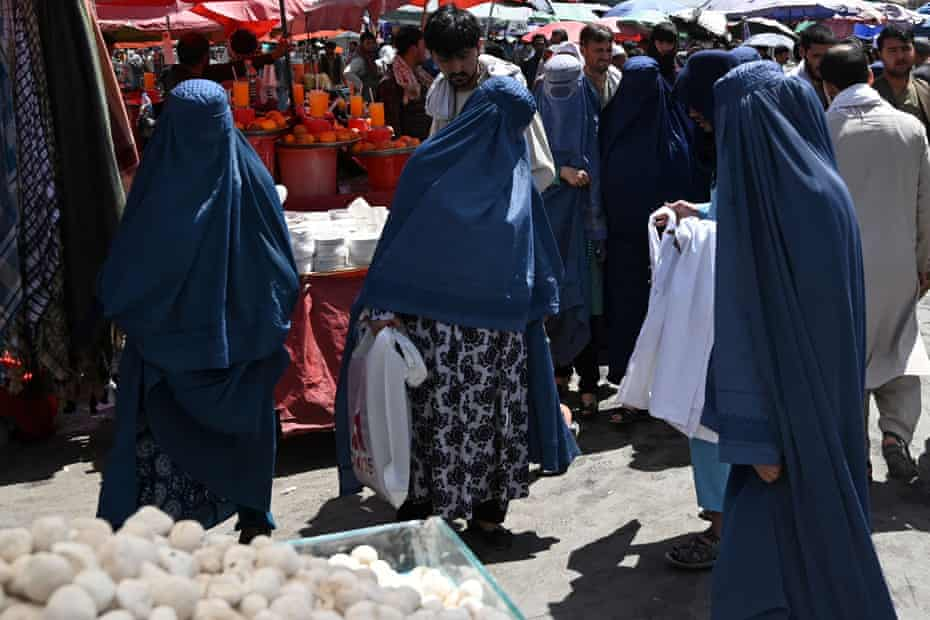 Women shop at a market in central Kabul on Saturday.