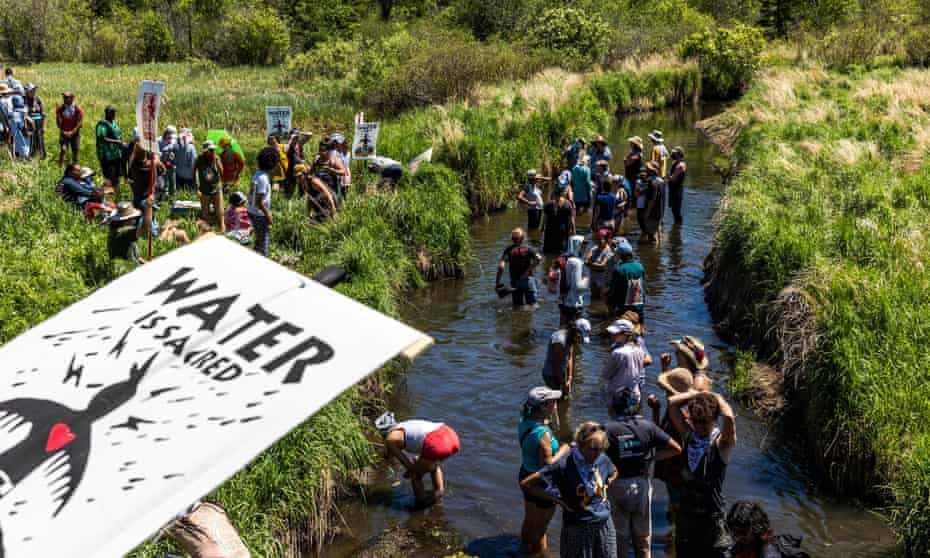 Climate activists and Indigenous community members march to protest the construction of the Enbridge Line 3 pipeline in Solvay, Minnesota, in June.