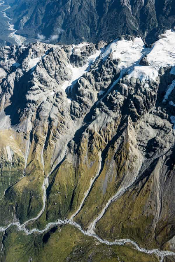 Scientists take images of the snowline around glaciers on New Zealand's south island.