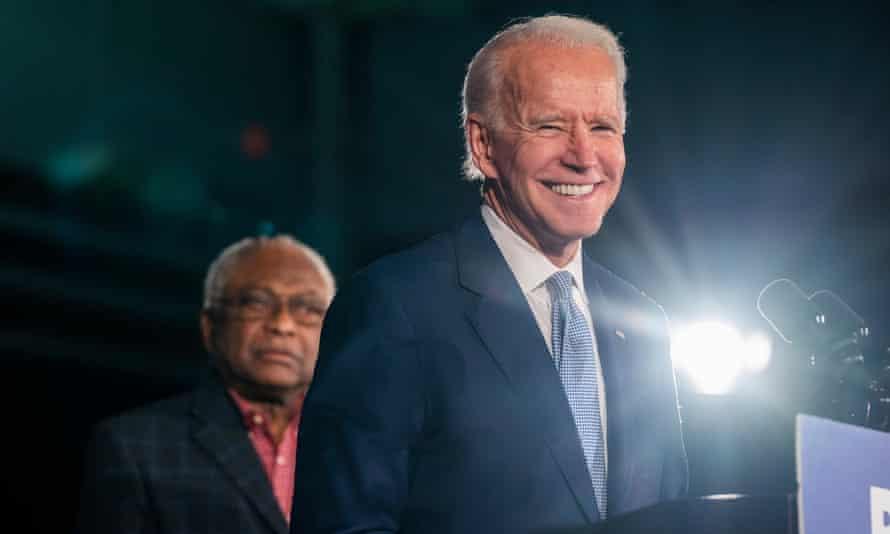 Joe Biden speaks as Jim Clyburn listens in Columbia, South Carolina, on 29 February.