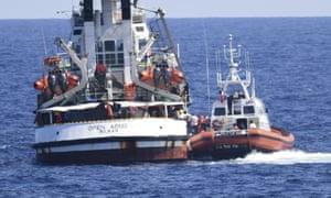 An Italian coastguard vessel beside the Open Arms
