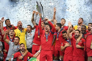 Portugal lift the trophy.