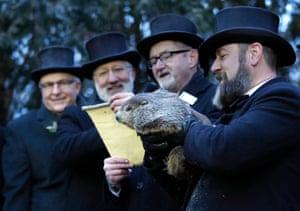 Groundhog Club inner circle members listen as their vice-president, Jeff Lundy, reads Punxsutawney Phil's prediction