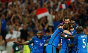 Griezmann celebrates with his teammates after scoring the crucial second.