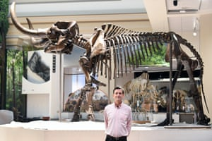 Dr Scott Wing, a research geologist, stands in front of an American mastodon.