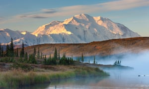 Denali towers over Wonder Lake at dawn