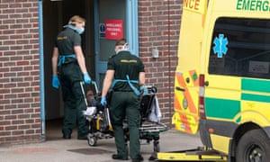 A coronavirus patient is taken to hospital
