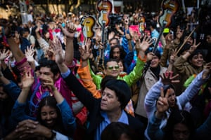 People dressed as members of the Beatles raise their hands during an attempt to set a new Guinness World Record for the highest number of people dressed as the band at Chapultepec park in Mexico City