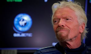 Sir Richard Branson stands on the floor of the New York Stock Exchange ahead of the start of trading in Virgin Galactic in New York last year.