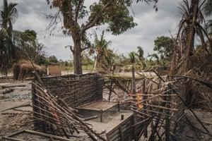 A destroyed house in the village of Aldeia da Paz